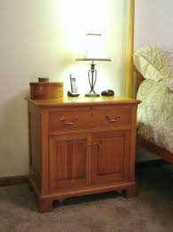 varnished teak wood bedside table with storage cabinet and drawers glass mirror bedside table