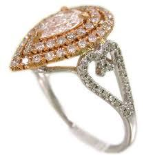 18k white and rose gold pear shape diamond engagement ring art