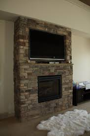 this existing stone fireplace was in need of repairs and a gas the decorations stone veneer around fireplace design ideas stack cubtab fire place designs with tv home decor