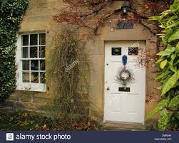 wreath hanging front door traditional country english cottage