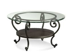 beautiful round glass and metal coffee table with stacking round