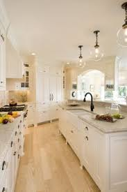 brown granite in a beautiful white kitchen in a model home in