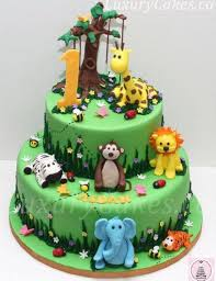 jungle theme cake jungle themed cake bit no fondant plastic animals and candy