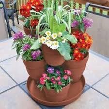 best 25 flower pot tower ideas on pinterest stacked flower pots