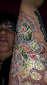exclusive woman sues harlem tattoo shop after infection ny