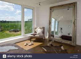 Bedroom Design Kent Chair At Window With Oversized Mirror In Bedroom Of Carbon Neutral