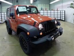 wrangler jeep 4 door black 2015 jeep wrangler willys wheeler sunset orange black grille