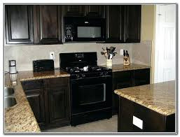black kitchen appliances appliance cabinets kitchens black appliances and white or gray