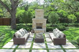 outdoor living room with fireplace white tile floor rattan varnish