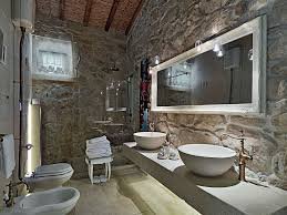 bathroom with stone walls and vessel sinks rural rustic interior