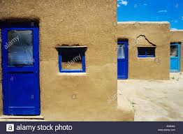 adobe houses adobe houses with blue windows and door frames stock photo
