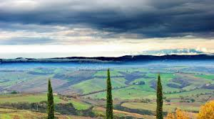 field montepulciano tuscany italy valley fields cultivated clouds