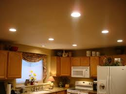 cheap kitchen lighting ideas lighting idea the white cabinet picture frame on the wall