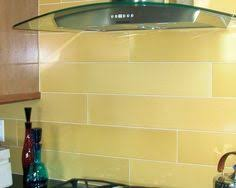 yellow kitchen backsplash ideas yellow glass subway tile subway tiles kitchen backsplash and stools