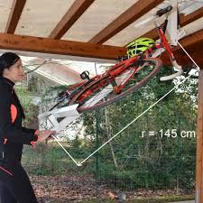 flat bike lift store your bike flat against ceiling your