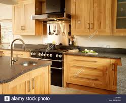 island units for kitchens chrome tap and sink set in central island in kitchen with wood