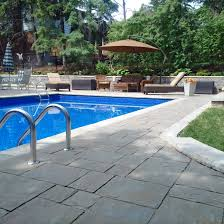 Pool Patio Furniture by Creating The Perfect Pool Patio Area Unilock
