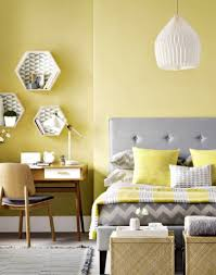 gray and yellow bedroom walls white framed bed with storage for