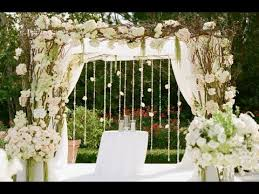 wooden wedding arch with floral garland