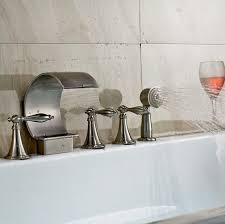 deck mount brushed bathtub faucet with handheld shower on sale