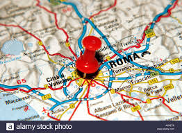 rome on a map map pin pointing to rome italy on a road map stock photo
