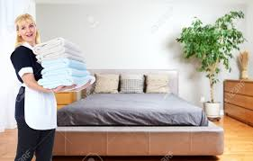 maid woman with towels house cleaning service concept stock