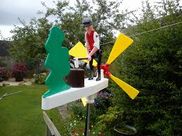 retro vintage type wood chopping whirligig whirlygig garden
