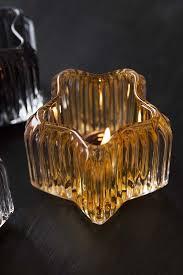star shaped tea lights golden glow glass star shaped tea light holder from rockett st george