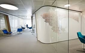 glossy glass wall partition futuristic blue chairs shiny ceiling