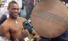 mario balotelli gets genghis khan quote tattooed on his chest to