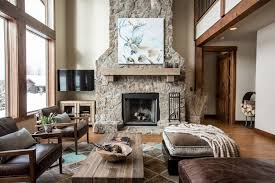 rustic living room furniture ideas with brown leather sofa home decor rustic living room animal art stones fireplace