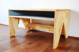 plywood bed frame designed for optimum storage apartman studio