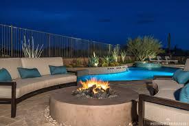 relax poolside in this resort style arizona backyard