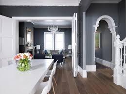 living room with tall table lamps and grey walls decorating