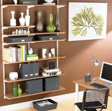 in the bedroom turned into compact home office with ample storage