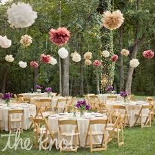 paper tissue pom poms decor for outdoor reception but stick with