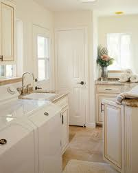 Laundry Utility Sink With Cabinet by Utility Sink With Cabinet Kitchen Mediterranean With Bar Pulls