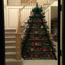 ladder christmas tree this is made with a ladder and boards screwed to the steps and