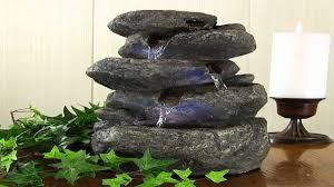 sunnydaze tiered rock and log tabletop fountain with led lights