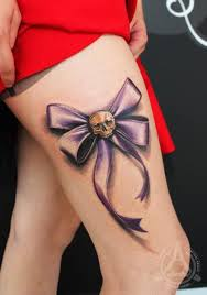 skull ribbon ribbon thigh tattoo by led coult