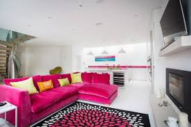 pink sofas an unexpected touch of color in the living room sofa coordinates with area rug and kitchen accents
