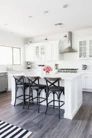 best 25 grey hardwood floors ideas on pinterest gray wood my white kitchen stoegbauer home tour 2016 victoria white quartz countertops white subway tile backsplash