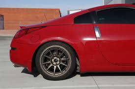 red nissan 350z ambit wheels re18 18x9 5 18x10 5 15 5x114 3 nissan 350z z33