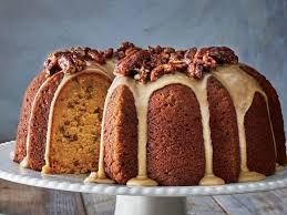 pumpkin spice bundt with brown sugar icing and candied pecans