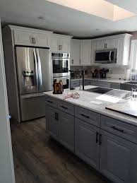 raising kitchen base cabinets dove white raise panel cabinets with custom painted base