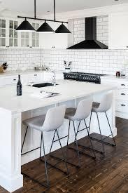 white shaker kitchen cabinets with white subway tile backsplash white kitchen cabinets with black hardware countertopsnews