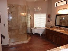 bathroom glass shower with hardwood flooring plus wall sconce and