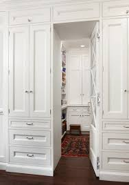 hidden pantry behind mirrored cabinet door transitional kitchen
