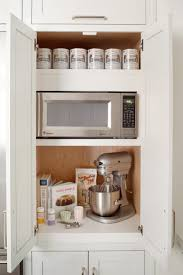 kitchen cabinets with shelves 14 strategies for hiding the microwave remodelista