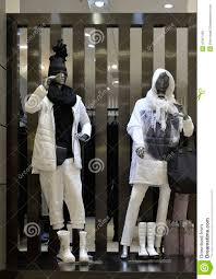 Store Window Design Man Fashion Clothing Shop Window With Mannequins In Down Coat